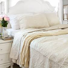 white and beige bedding