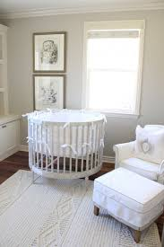 nursery room with neutral walls and framed wall decor cheap