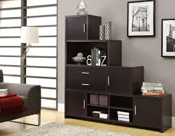 black wooden stair bookcase with square door on laminate flooring