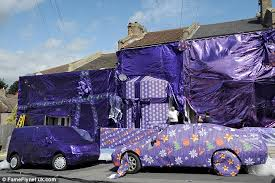 car wrapped in wrapping paper cadbury wraps houses in purple fabrics for festive advert in