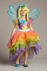 girls rainbow dress chasing fireflies
