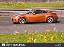 nissan fairlady 350z a nissan 350z fairlady z z33 u201d sports car travelling along the