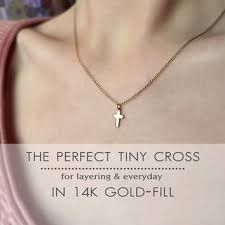 avery crosses shop tiny gold cross necklace on wanelo