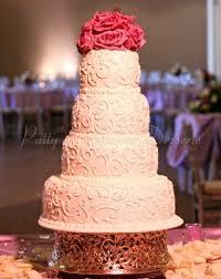 beautiful created four tier wedding cakes