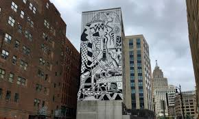 16 beautiful reasons why detroit has the best public art around this new piece on the side of the new 28 grand micro lofts in downtown detroit is by legendary detroit artist charles mcgee he created various murals in