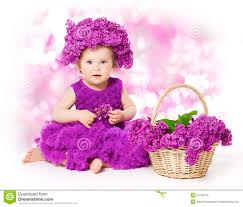baby flowers baby girl lilac flowers kid in flower child bouquet stock