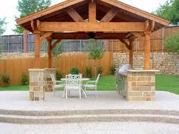 outdoor living room pergola brown wooden floor round steel chrome