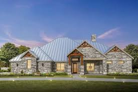 country ranch house plans 4 bed hill country ranch house plan with stone exterior 430007ly
