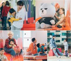 winner plays with adorable children for upcoming reality show