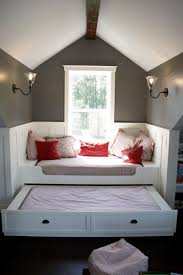 interior stunning grey attic bedroom with space saving bed design