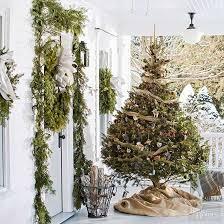 how to hang lights on a christmas tree how to put lights on a christmas tree better homes gardens