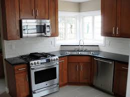Black Kitchen Cabinets White Subway Tile White Subway Tile Backsplash Black Countertop Medium Dark