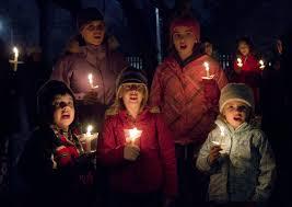 spirit halloween adrian mi carolers rejoice christmas songs hit the airwaves earlier than