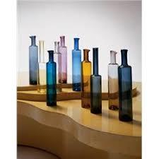nanny still of ten ornamental bottles ca 1959 molded