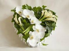 Funeral Flower Designs - all yellow funeral heart with sunflowers and yellow roses