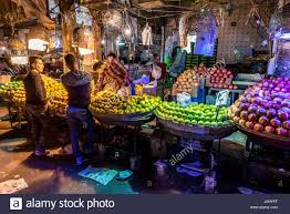 heap of fruits for sale on a small market place in shiraz city