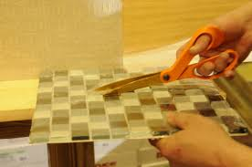 how to install a glass tile backsplash in the kitchen glass tile diy yes you can install your own backsplash with video