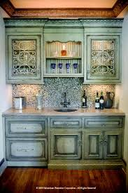how to paint cabinets to look distressed a wet bar done with green cabinets with a distressed finish did i