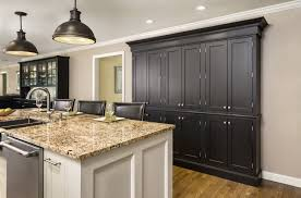 marble countertops kitchen with black cabinets lighting flooring