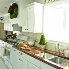 Photos HGTV - White kitchen cabinets with butcher block countertops