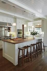 butcher block kitchen island breakfast bar cottage kitchen with kitchen island l shaped inset cabinets
