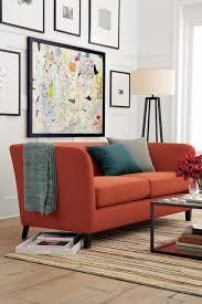 crate and barrel living room design ideas rust and teal in a living room by crate barrel