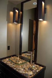 glass washbowl on the bathroom vanity connected by rectangle black