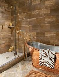 feng shui bathroom with copper freestanding tub and gold showers