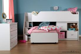 bedroom bed with trundle for kids with blue wall design and kids