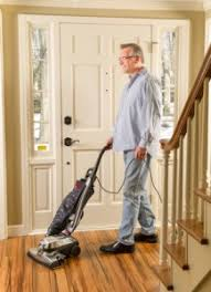 vacuuming hardwood floors with your kirby