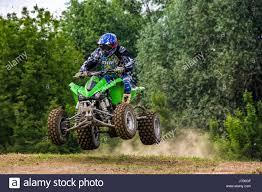 action motocross uzhgorod ukraine may 21 2017 atv rider in dirt bike jumping
