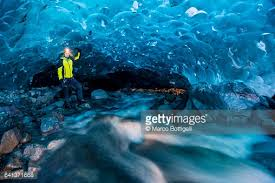 The Crystal Cave Iceland Flowing River Inside A Crystal Ice Cave In Winter Iceland Stock