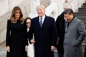 trump arrives in china to lavish welcoming ceremony amid tensions