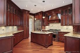 Traditional Dark WoodCherry Kitchen Cabinets Style Pinterest - Cherry cabinet kitchen designs