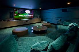 interior adorable blue home theater room featuring cozy sofa