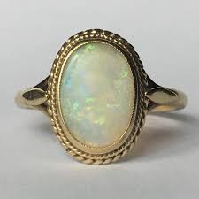 opal october vintage opal ring 2 carat oval white opal 9k yellow gold