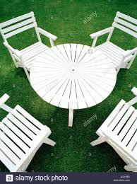 white outdoor furniture on green lawn stock photo royalty free