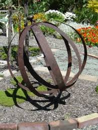 Metal Bugs Garden Decor How To Make Iron Sphere Rusted In Garden Ornaments Eclectic