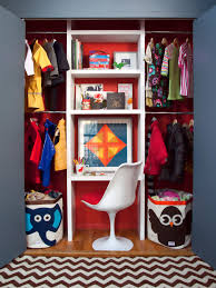walk in closet for small bedroom with brown wooden drawers and
