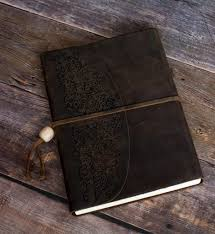 leather bound photo book leather bound journal book on a barn board floor evalogue