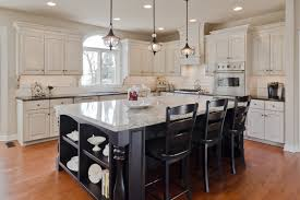 novel off white cabinets with dark island kitchen 736x488