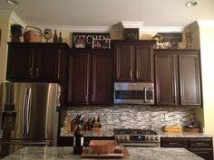 Decorating The Top Of Kitchen Cabinets Lanterns On Top Of Kitchen Cabinets Decor Ideas Pinterest