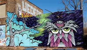 wall art bikes books a little music page 2 an owl in the acid forest on a wall in the lincoln street art prk