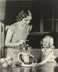 yum woman and child test out a ge electric juicer in 1936