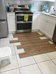 white kitchen cabinets with vinyl plank flooring what color vinyl flooring for this white kitchen