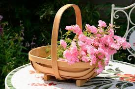 basket of flowers basket of flowers stock photo image of flower chair 56125330