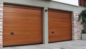 porte sezionali porta sezionale oregon con pannellatura in legno ballan