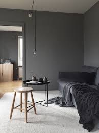 moody colours in the living room masculine living room in grey
