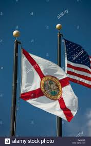Florida Flag History Florida State Flag United States Flag Flying On Flagpoles On Blue