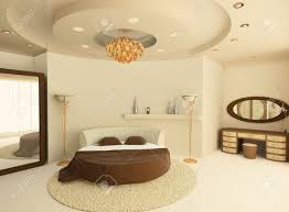 3d round bed with a suspended ceiling in a luxurious bedroom stock